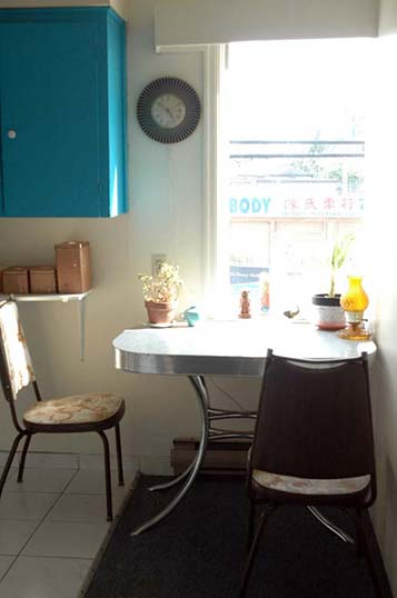 This picture shows a 1950s mid-century arborite table and two 1970s kitchen chairs.